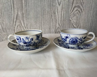 Two antique cups and saucers
