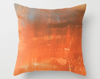 Abstract paint effect pillow in rust or pink tones, art studio interior decorating for creatives