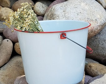 White Enamel Bucket with Red Trim and Red, Wooden Handle. Use as fun farmhouse decor or for functional use!
