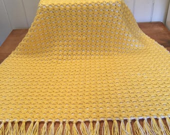 Yellow and white hand crocheted afghan