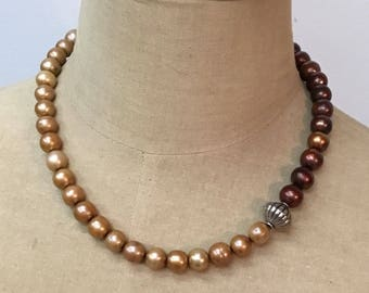 Handmade two-toned freshwater pearl necklace with sterling silver accent bead