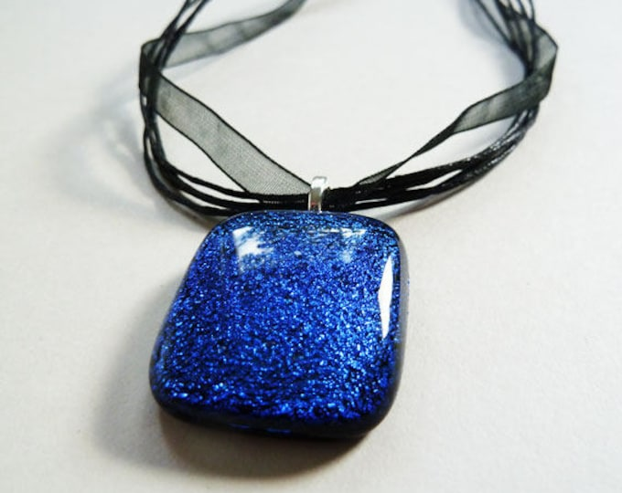 Deep royal blue and black fused dichroic glass pendant.