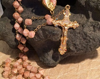 Gold tone coated pewter cross with pink stones Rosary