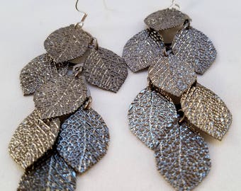 Silver cascade of leaves earrings.