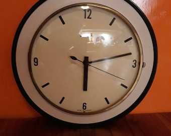 Featuring vintage wall clock