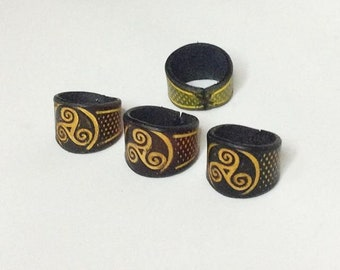 Leather rings. Triskel.