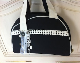 Black and white fabric bag with lace on the front