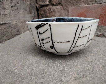 Hand drawn handmade porcelain bowl