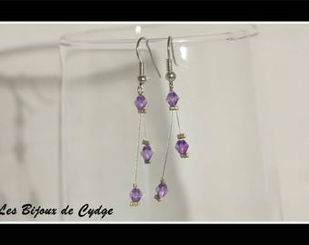 Earrings on twisted wire and its purple bicone bead