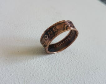 a handmade 1948 one penny coin ring patina finish