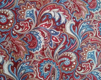 Paisley print in reds and blues.