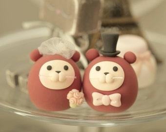 Otters wedding cake topper
