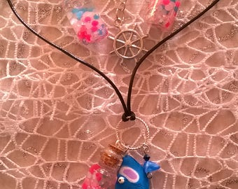 Glass bottles and blue and pink fish set