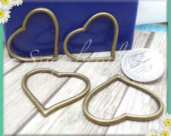 4 Elegant Brass Heart Connectors or Pendants 28mm