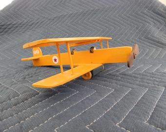 toy yellow biplane