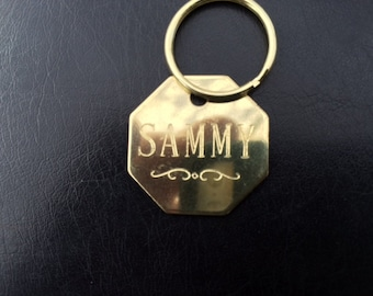 Solid Brass 1 inch octagon tag with a curley decoration