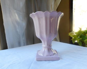 Soft pink vase, or planter, nothing stamped on bottom, been around for a while