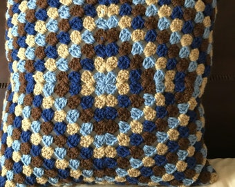 Granny square crocheted throw pillow