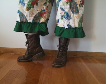 Pretty as a Peacock bloomers with green ruffles.