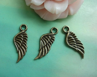 A bronze feather wing steampunk pendant