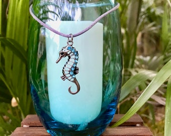 Starfish pendant on an elegant beachy blue glass candle holder with a soy pillar.