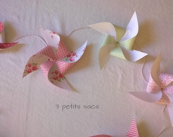 11 Garland windmills, papers: red, pink, green and white. vintage vibe