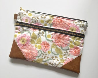 White floral double zip clutch with gold chevron interior