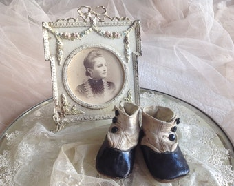 Sweet antique black and white 1900's leather buttoned baby shoes