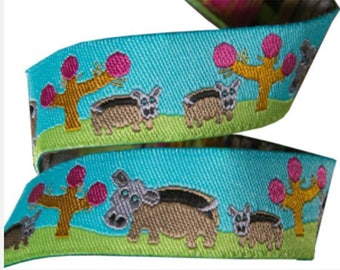 5/8-inch woven jacquard ribbon, hippo on turquoise background