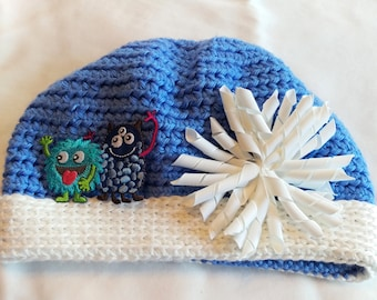 JORDAN hat. A dishy slouchy hat for boys and girls of all ages, soft blue, white brim, monster or flower embellishment