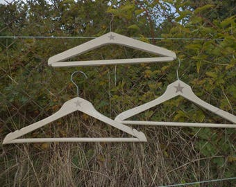 3 wood hangers taupe color old patina
