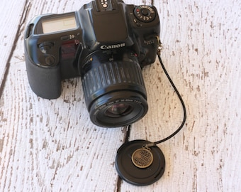 Lens Cap Holder - Hide Your Crazy Charm - Camera Strap for Lens Cap