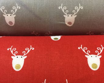 Reindeer head cotton fabric by the metre available in two colours