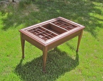 Traditional style coffee table custom made with cherry wood and a reclaimed wood type case for displaying collections and keepsakes.