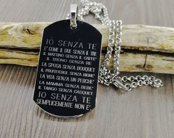 Stainless steel pendant with engraved sentence. 30 x 50 mm