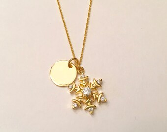 Gold snowflake pendant necklace with cubic zirconia and dainty chain