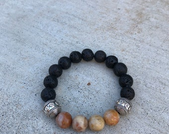 Moroccan Agate and Lava Beads with Silver Bali beads. Comes with vial of essential oils.