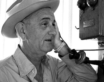 President Lyndon B. Johnson Talks on an Antique Phone at the LBJ Ranch - 8X10 Photo (BB-102)