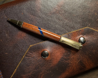 The Guide Handmade ballpoint pen for travel in Santos Mahogany and antique brass by The Acadian