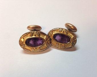 Cufflinks with purple rhinestone.