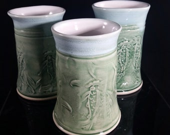 Green textured porcelain tumblers with thumb grip