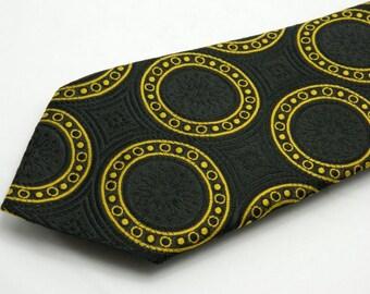 1970s Vintage St Michael Black and Gold Medallion Patterned Retro Disco Neck Tie