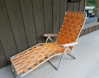 Vintage aluminum folding lawn chair lounger chaise lounge webbed orange retro metal