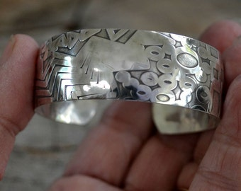 Sterling patterned cuff bracelet.  domed 3/4 inch wide.  Size small (slightly adjustable)