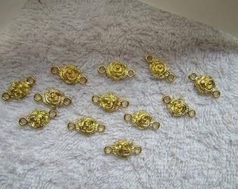 CONNECTEURS MOTIFS ROSES 1,9 cm dorés  motif roses a deux boucles lot de 12 unités couleur dorée