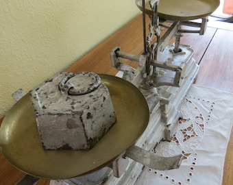 """Antique Cast Iron Scale from Germany. Silver cast iron with 2 brass pans, """"Force""""  """"15 KILOG"""" kilograms on base. Comes with refashioned arm."""