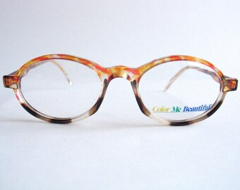 Vintage multicolor transparent oval eyeglasses frame made in Italy in the 80's.