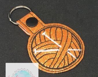 Yarn ball with knitting needles keychain