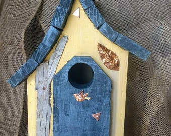 Outdoor or indoor, one of a kind, handmade in Michigan birdhouse. Easy clean out, hanging, rustic, and affordable!