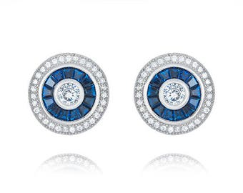 Rhodium plated Sterling Silver round Blue Spinel post earrrings.